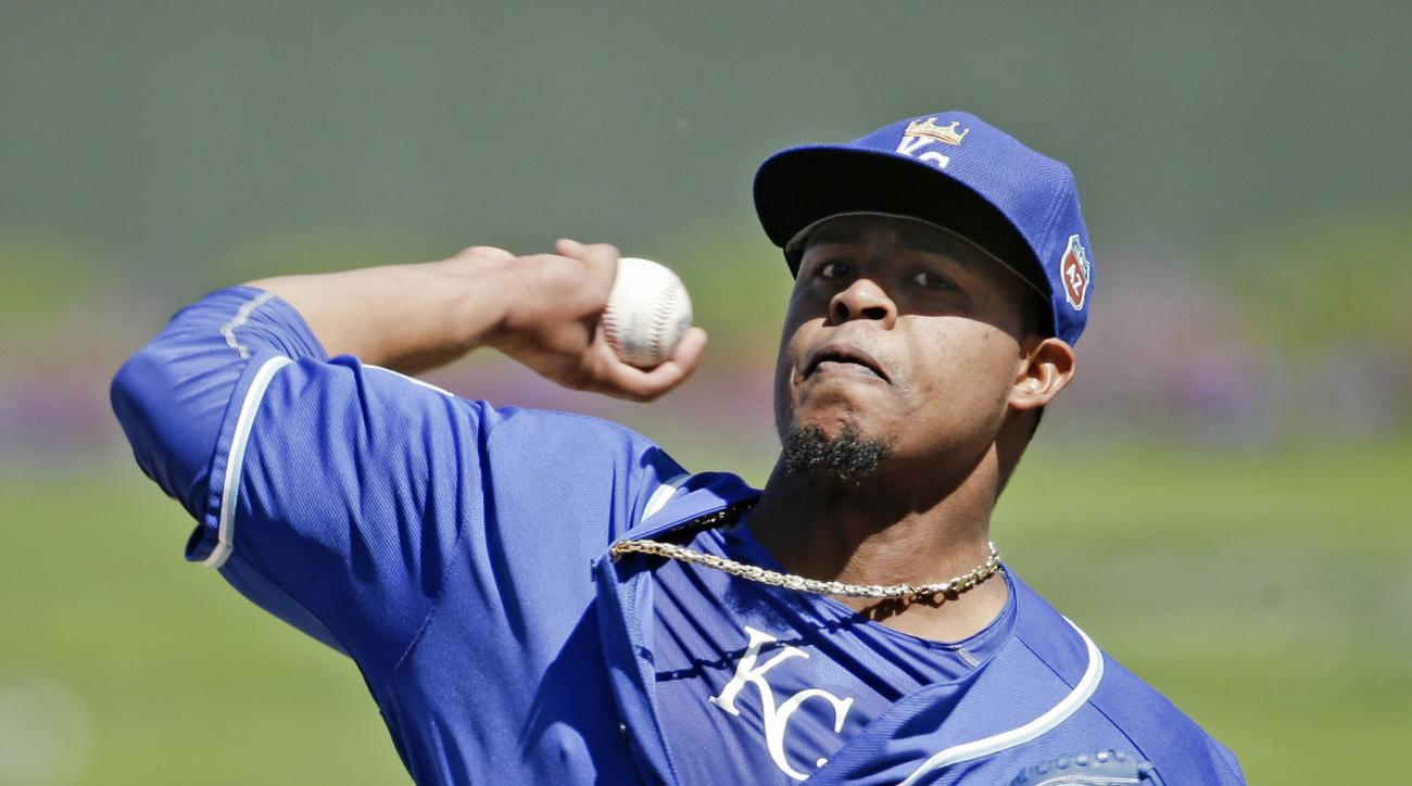 Kansas City Royals starting pitcher Edinson Volquez throws during the first inning of a spring training baseball game against the Colorado Rockies Tuesday, March 8, 2016, in Surprise, Ariz. (AP Photo/Charlie Riedel)