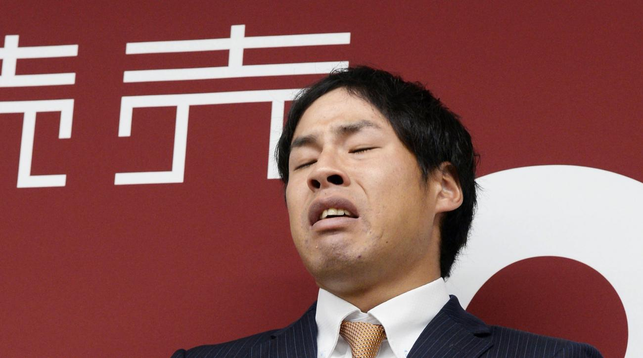 Yomiuri Giants pitcher Kyosuke Takagi cries as he speaks during a press conference at the baseball team's office in Tokyo Wednesday, March 9, 2016. Takagi was found to have bet on baseball games after three others of his teammates received indefinite susp