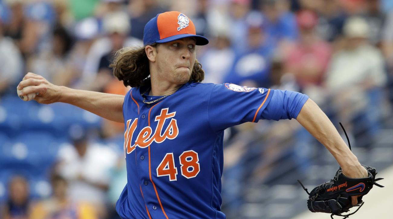 New York Mets starting pitcher Jacob deGrom throws during the first inning of an exhibition spring training baseball game against the New York Yankees Wednesday, March 9, 2016, in Port St. Lucie, Fla. (AP Photo/Jeff Roberson)