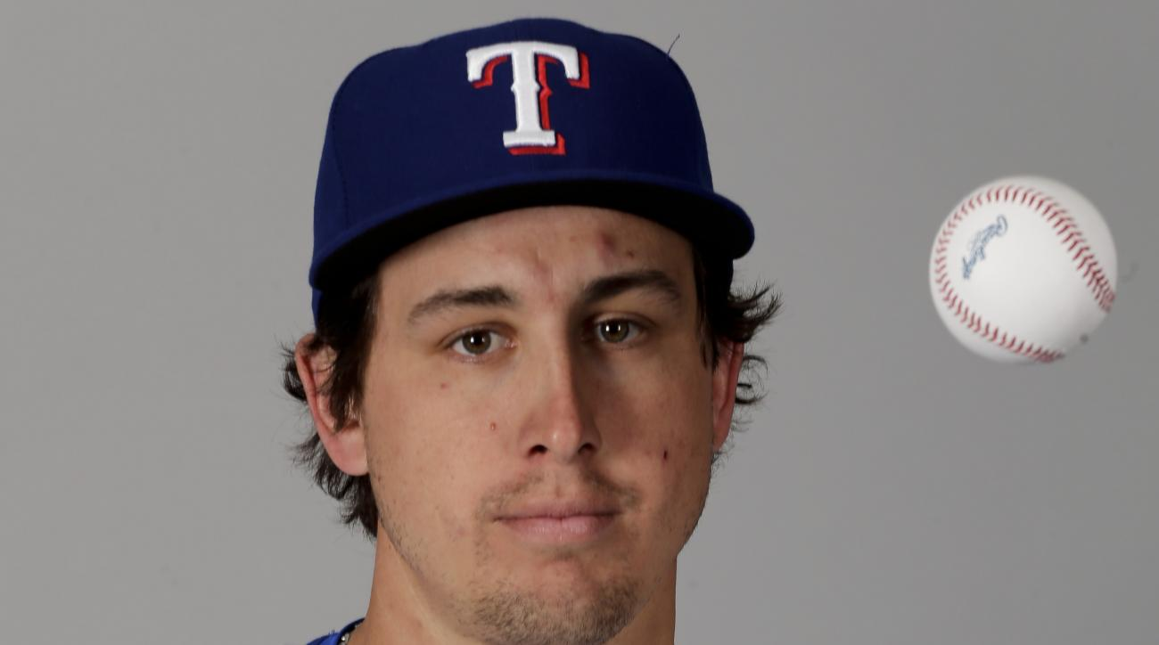FILE - This is a 2016 file photo showing Derek Holland of the Texas Rangers baseball team. Derek Holland has no interest in looking back, and instead prefers talking positively about what's ahead after two injury-shortened seasons. (AP Photo/Charlie Riede