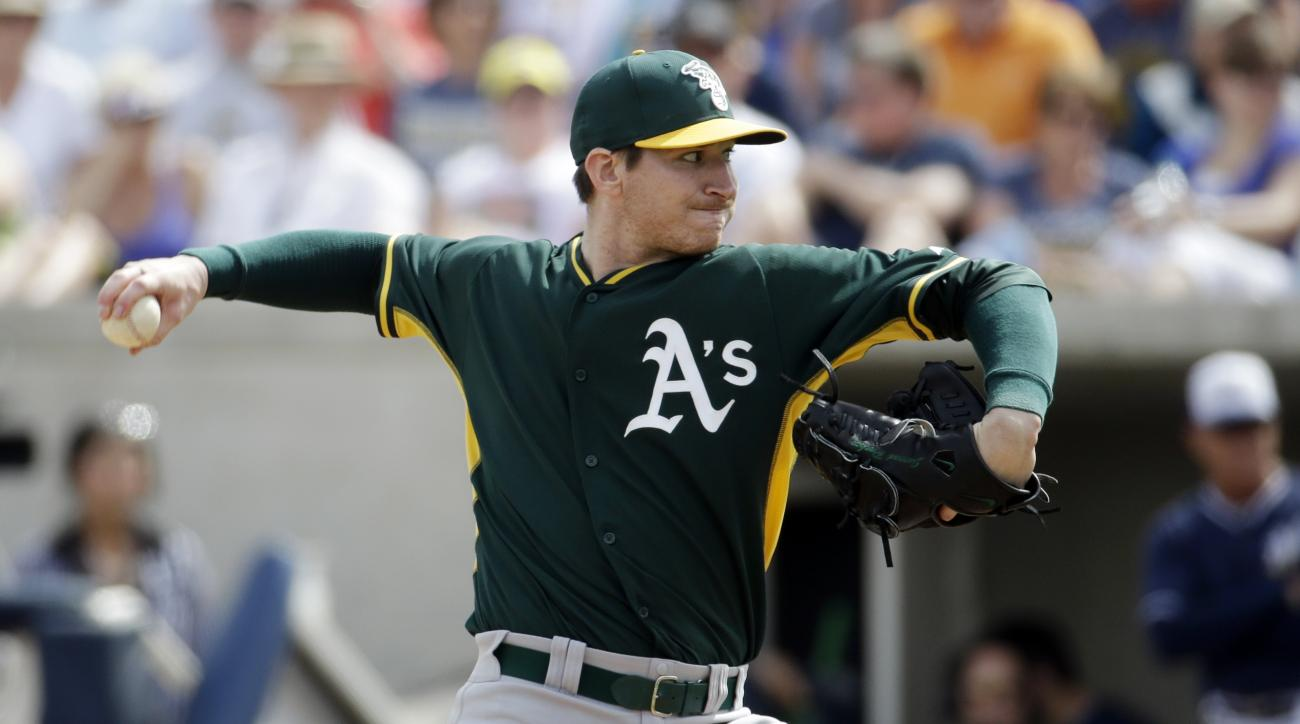 FILE - In this Wednesday, March 5, 2014 file photo, Oakland Athletics' Jarrod Parker throws during the first inning of an exhibition spring training baseball game against the Milwaukee Brewers in Phoenix. Trying to come back from a series of elbow injurie