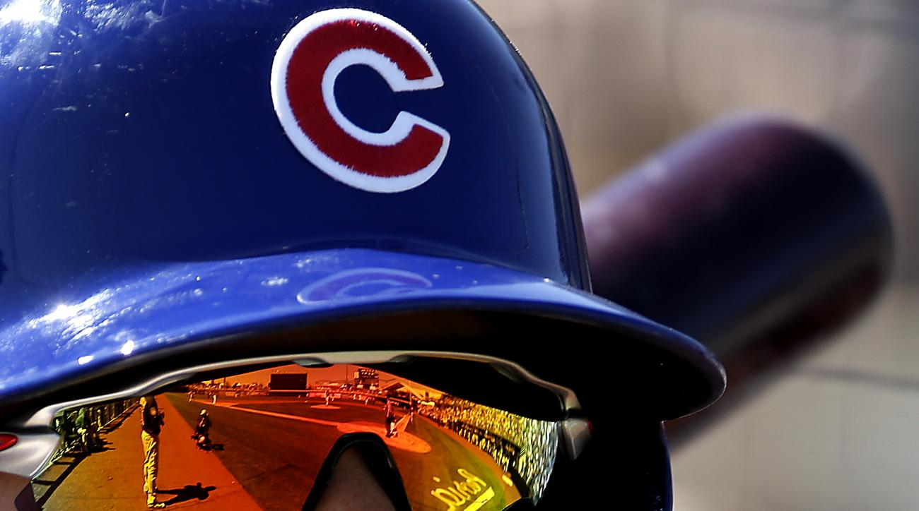 Chicago Cubs' Javier Baez waits on deck to bat during the first inning of a spring training baseball game against the Seattle Mariners Thursday, March 10, 2016, in Peoria, Ariz. (AP Photo/Charlie Riedel)