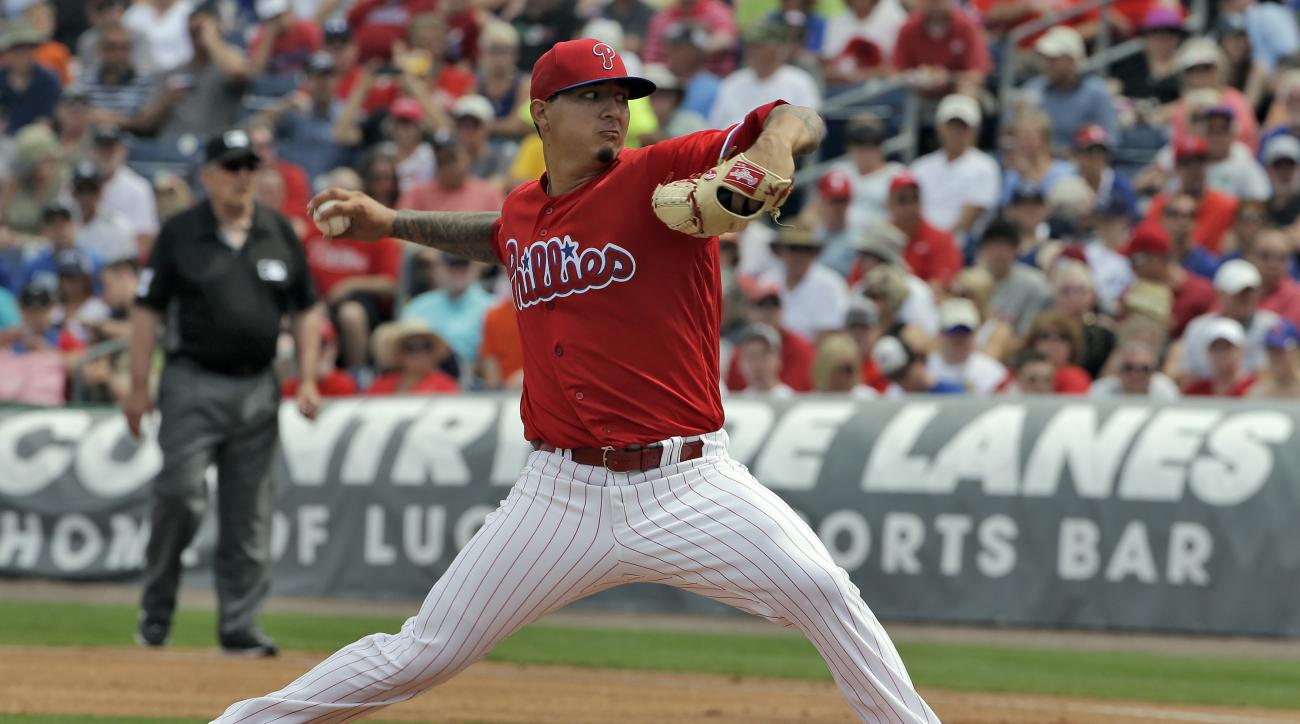 Philadelphia Phillies pitcher Vince Velasquez goes into his windup against the Toronto Blue Jays during the first inning of a spring training baseball game Saturday, March 12, 2016, in Clearwater, Fla. (AP Photo/Chris O'Meara)