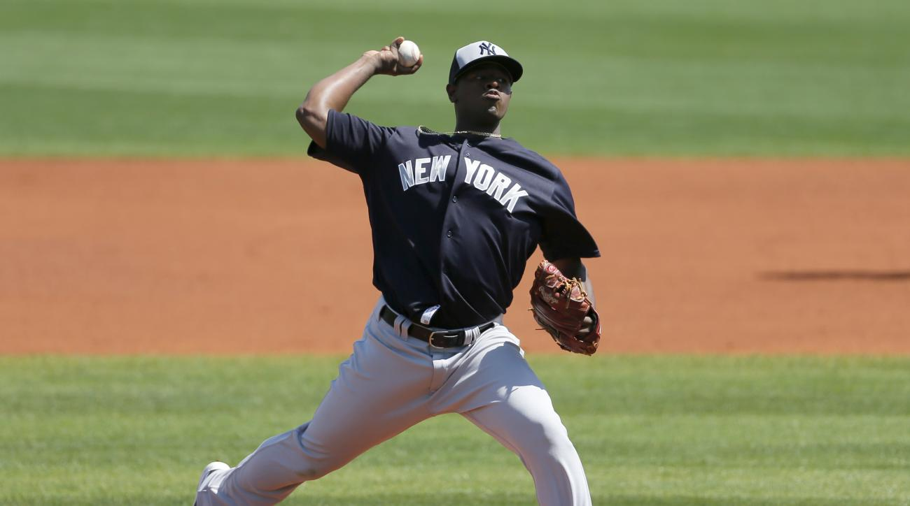 New York Yankees starting pitcher Luis Severino works against the Tampa Ba Rays in the first inning of spring training baseball game, Saturday, March 12, 2016, in Port Charlotte, Fla. (AP Photo/Tony Gutierrez)