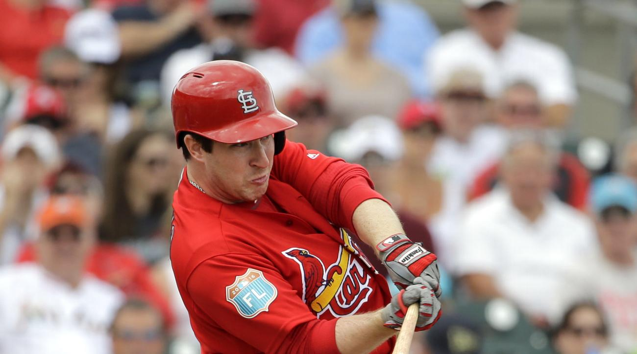 FILE - In this March 5, 2016, file photo, St. Louis Cardinals' Jedd Gyorko flies out during the first inning of an exhibition spring training baseball game against the Miami Marlin, in Jupiter, Fla. Before Jhonny Peralta was sidelined with a thumb injury,
