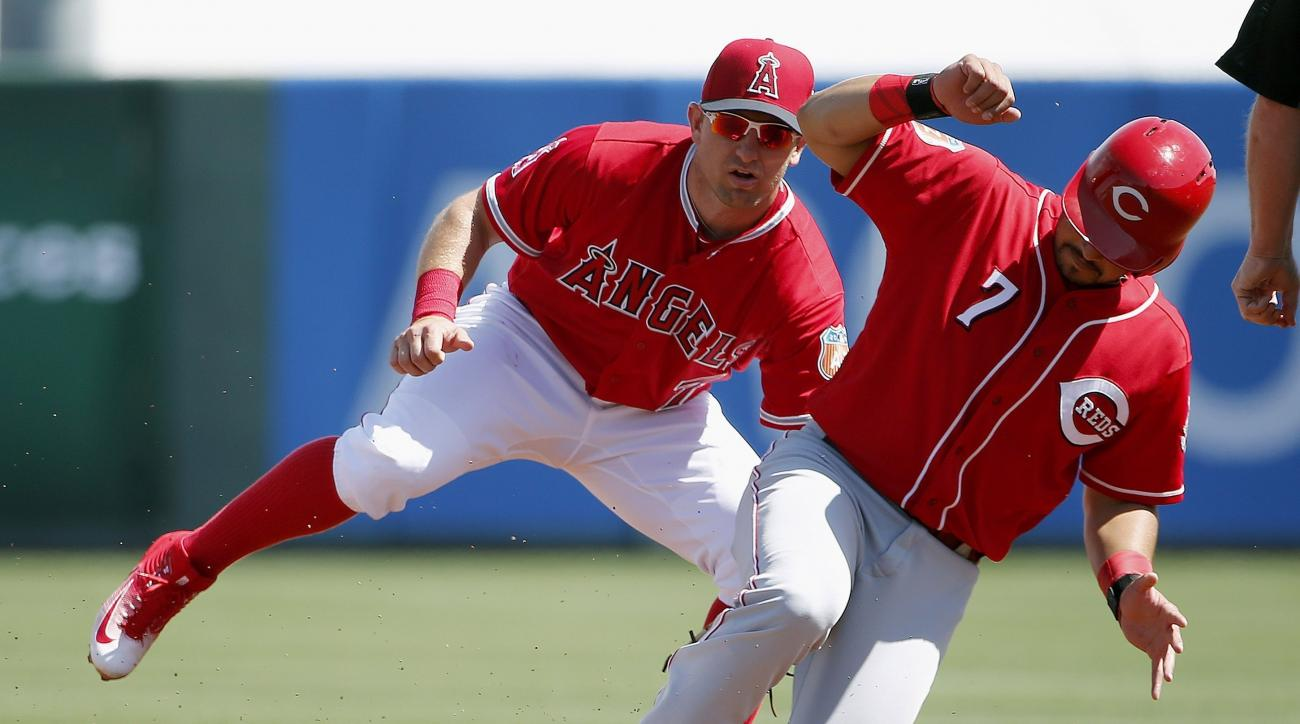 Los Angeles Angels' Cliff Pennington, left, tags out Cincinnati Reds' Eugenio Suarez (7) who was trying to steal second base during the first inning of a spring training baseball game Monday, March 14, 2016, in Tempe, Ariz. (AP Photo/Ross D. Franklin)