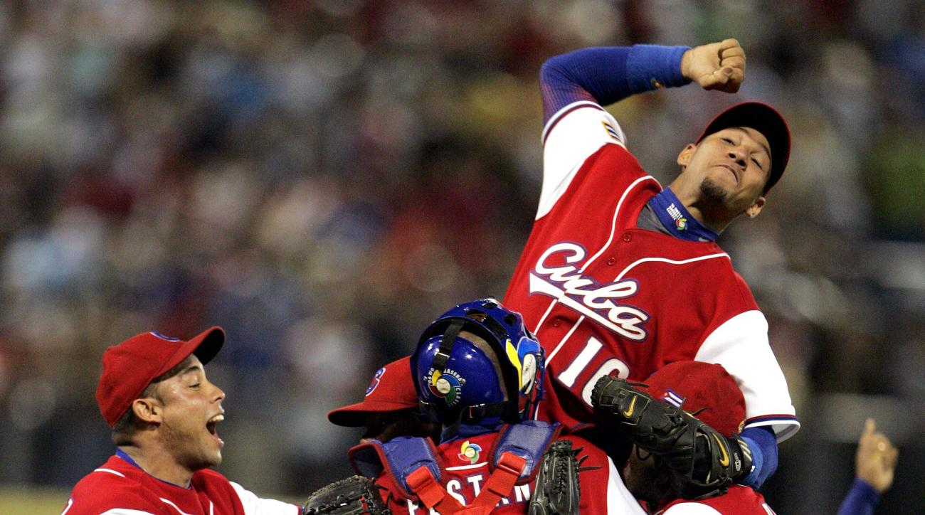 FILE - In this March 15, 2006, file photo, team Cuban second baseman Yulieski Gourriel (10) celebrates with his teammates after Cuba defeated Puerto Rico 4-3  the second round of the World Baseball Classic at Hiram Bithorn Stadium in San Juan, Puerto Rico