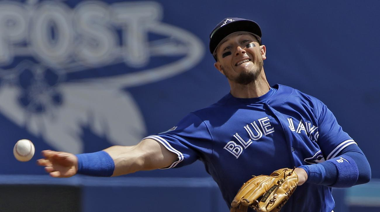 Toronto Blue Jays shortstop Troy Tulowitzki throws out Baltimore Orioles' Christian Walker at first base during the second inning of a spring training baseball game Tuesday, March 15, 2016, in Dunedin, Fla. (AP Photo/Chris O'Meara)