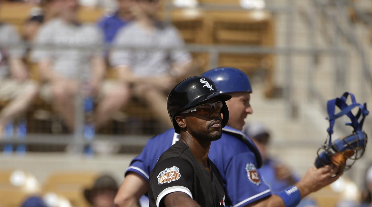 Chicago White Sox's Jimmy Rollins, front, throws his bat after striking out as Los Angeles Dodgers catcher A.J. Ellis walks off the field during the fourth inning of a spring training baseball game Tuesday, March 15, 2016, in Phoenix. (AP Photo/Jae C. Hon
