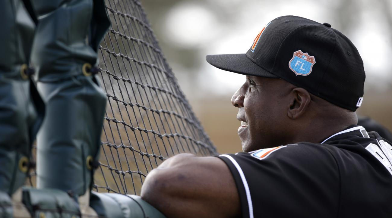 FILE - In this Feb. 22, 2016, file photo, Miami Marlins hitting coach Barry Bonds watches spring training baseball batting practice in Jupiter, Fla. Marlins slugger Giancarlo Stanton and Bonds showed off their home run prowess at spring training. What beg