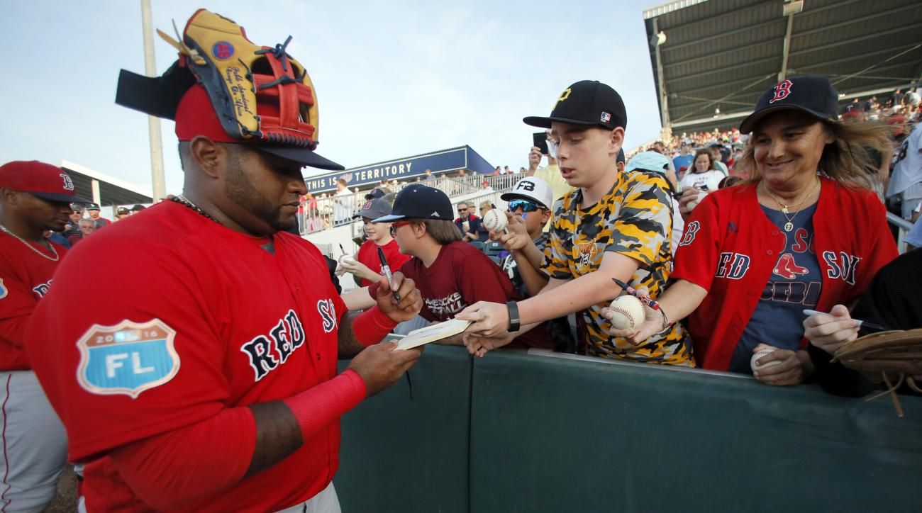 Boston Red Sox's Pablo Sandoval signs autographs for fans before the team's spring training baseball game against the Minnesota Twins on Wednesday, March 16, 2016, in Fort Myers, Fla. (AP Photo/Tony Gutierrez)