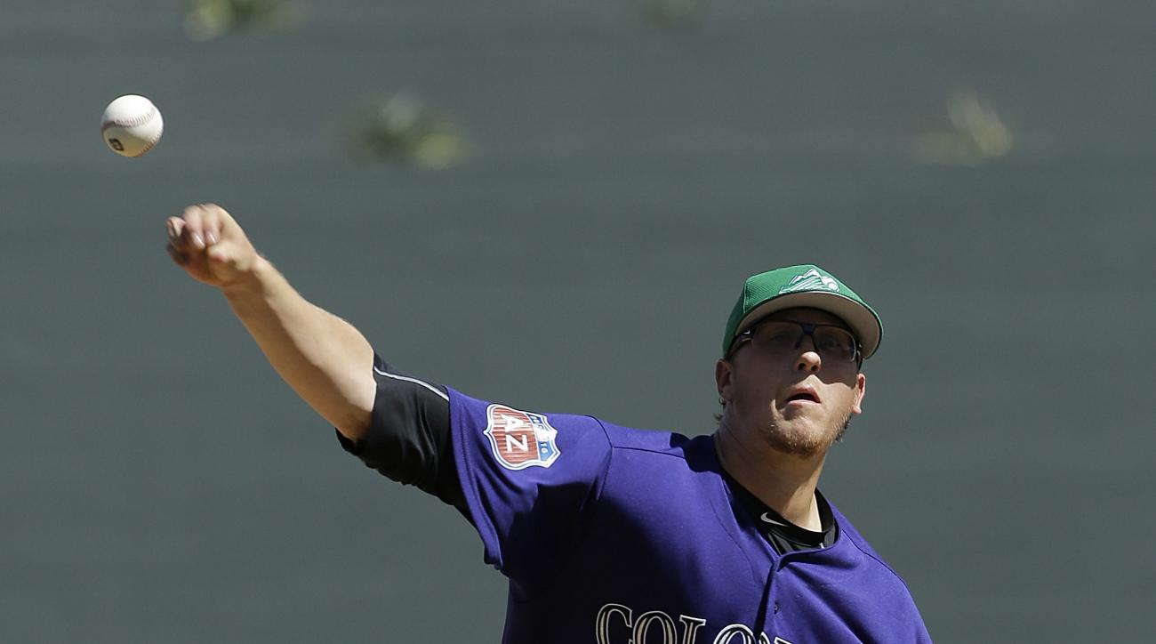 Colorado Rockies starting pitcher Jeff Hoffman throws before the first inning of a spring training baseball game against the Los Angeles Angels in Scottsdale, Ariz., Thursday, March 17, 2016. (AP Photo/Jeff Chiu)