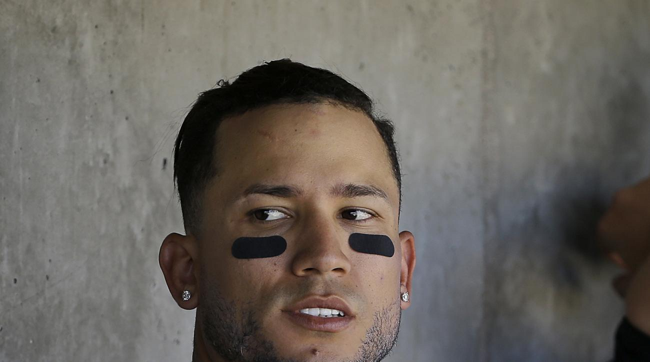 Colorado Rockies right fielder Carlos Gonzalez sits in the dugout during the third inning of a spring training baseball game against the Los Angeles Angels in Scottsdale, Ariz., Thursday, March 17, 2016. (AP Photo/Jeff Chiu)