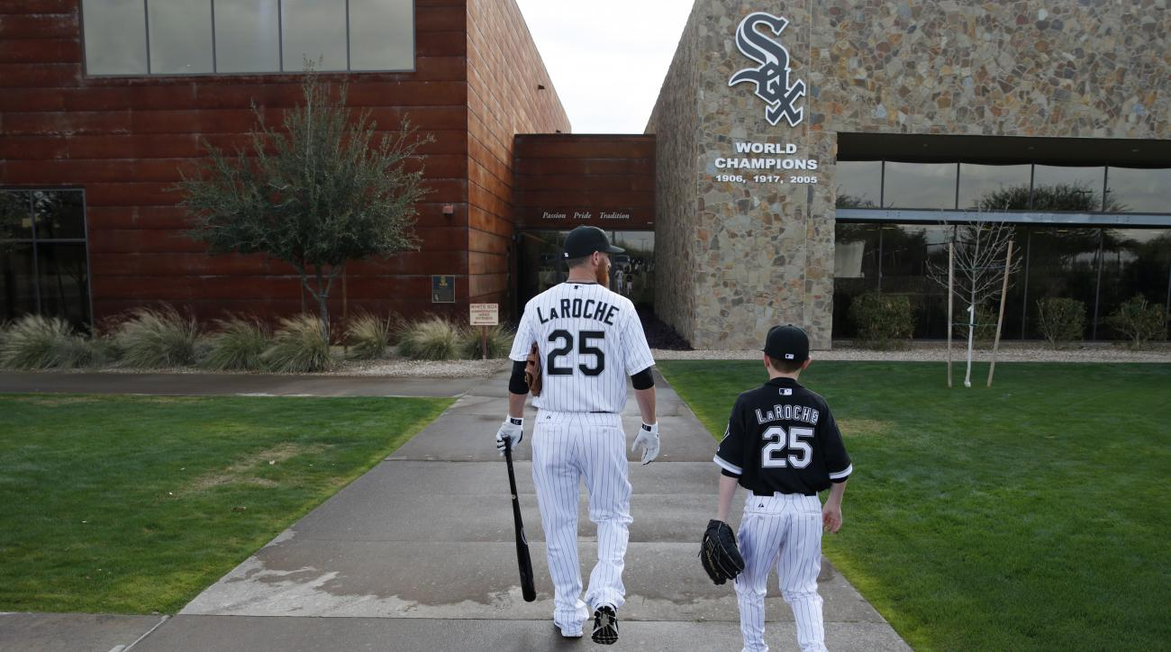 FILE - In this Feb. 28, 2015, file photo, Chicago White Sox's Adam LaRoche, left, and his son Drake walk to the White Sox's clubhouse during a photo day before a baseball spring training workout in Phoenix. Kudos to Adam LaRoche for wanting to spend time
