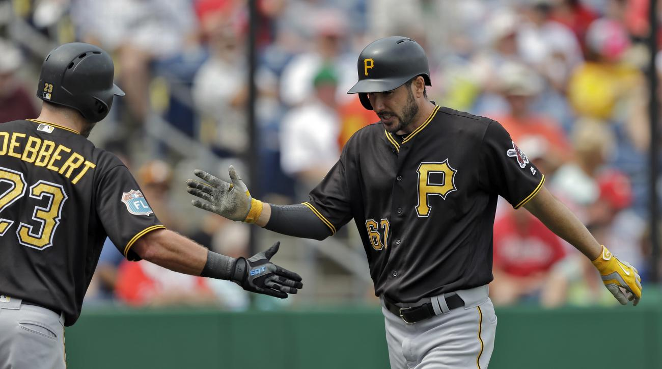 Pittsburgh Pirates' Matt Joyce, right, celebrates with Jake Goebbert after Joyce hit a home run off Philadelphia Phillies starting pitcher Charlie Morton during the third inning of a spring training baseball game Friday, March 18, 2016, in Clearwater, Fla