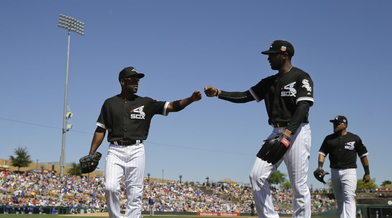 Chicago White Sox shortstop Jimmy Rollins, left, fist-bumps center fielder Austin Jackson as they walk off the field after the top of the fourth inning of a spring training baseball game against the Chicago Cubs Friday, March 18, 2016, in Phoenix. (AP Pho