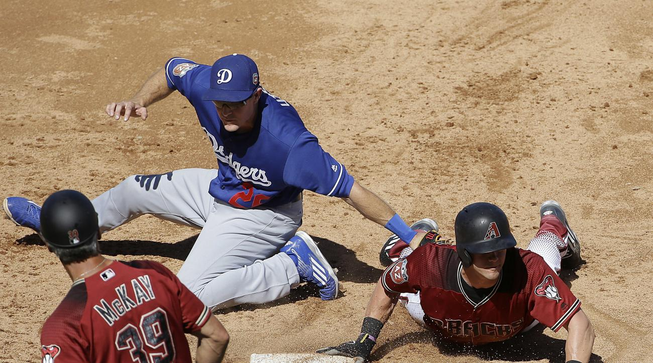 Arizona Diamondbacks' Evan Marzilli, right, slides back to first base next to Los Angeles Dodgers first baseman Chase Utley during the third inning of a spring training baseball game in Scottsdale, Ariz., Friday, March 18, 2016. (AP Photo/Jeff Chiu)