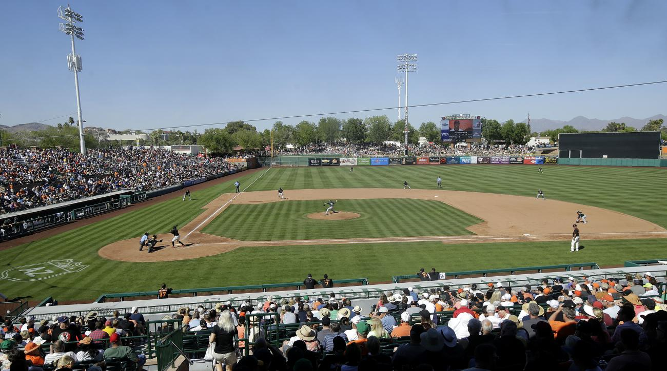 Fans at Scottsdale Stadium watch a spring training baseball game between the San Francisco Giants and the Oakland Athletics in Scottsdale, Ariz., Saturday, March 19, 2016. (AP Photo/Jeff Chiu)