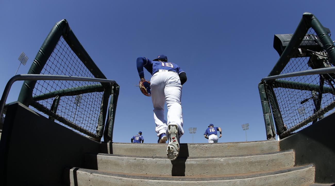 Texas Rangers' Jurickson Profar runs out of the dugout for the first inning of a spring training baseball game against the Los Angeles Angels, Sunday, March 20, 2016, in Surprise, Ariz. (AP Photo/Darron Cummings)