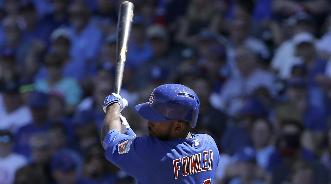 Chicago Cubs' Dexter Fowler triples against the Kansas City Royals during the third inning of a spring training baseball game in Mesa, Ariz., Sunday, March 20, 2016. (AP Photo/Jeff Chiu)