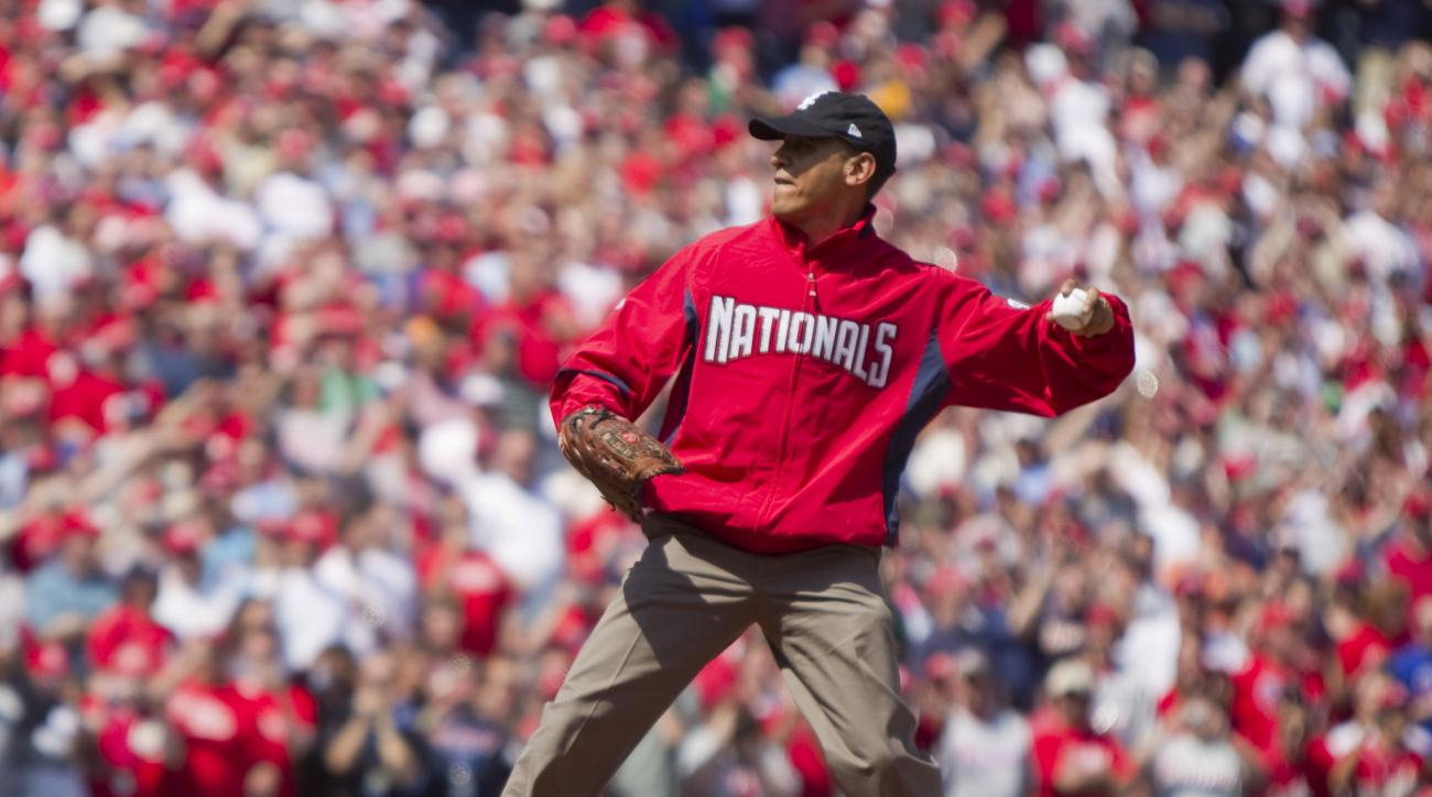 FILE - In this April 5, 2010, file photo, President Barack Obama, wearing a Washington Nationals jacket and a Chicago White Sox hat, delivers a ceremonial pitch before the Washington Nationals home opening baseball game against the Philadelphia Phillies a