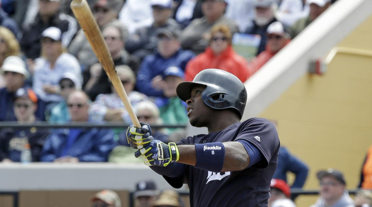 Detroit Tigers' Justin Upton hits a double in the first inning of a spring training baseball game against the Philadelphia Phillies, Monday, March 21, 2016, in Lakeland, Fla. (AP Photo/John Raoux)