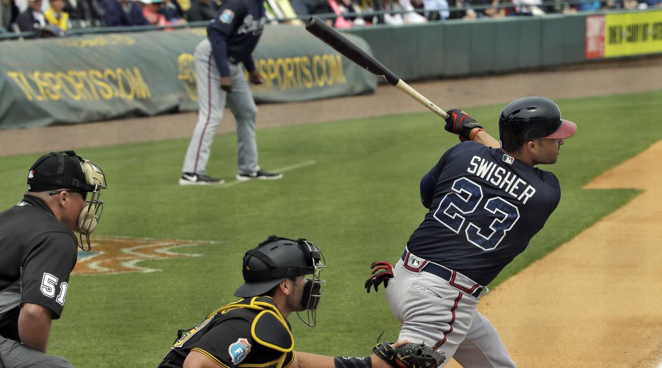 Atlanta Braves' Nick Swisher (23) connects for an RBI double off Pittsburgh Pirates starting pitcher Francisco Liriano during the first inning of a spring training baseball game, Monday, March 21, 2016, in Bradenton, Fla. Braves' Erick Aybar scored on the