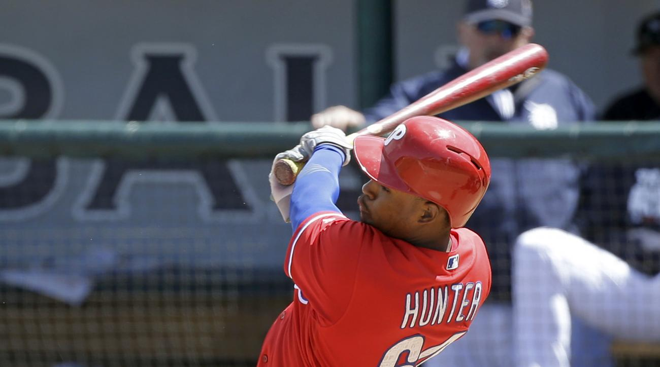 Philadelphia Phillies' Cedric Hunter hits a home run in the seventh inning of a spring training baseball game against the Detroit Tigers, Monday, March 21, 2016, in Lakeland, Fla. (AP Photo/John Raoux)