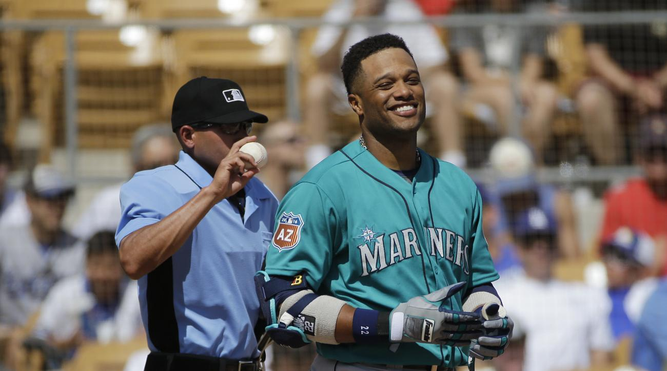 Seattle Mariners' Robinson Cano smiles after striking out during the third inning of a spring training baseball game against the Los Angeles Dodgers, Monday, March 21, 2016, in Phoenix . (AP Photo/Jae C. Hong)