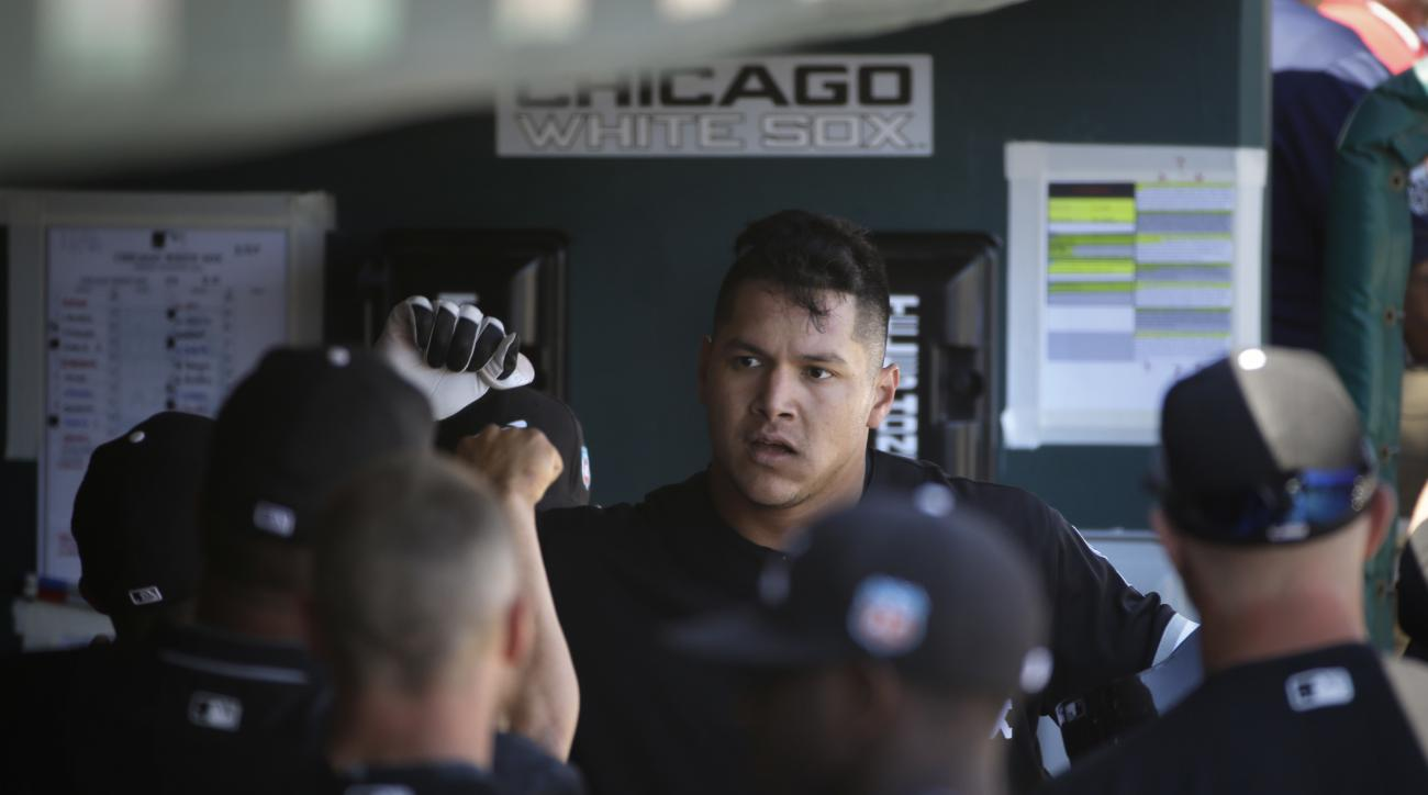 Chicago White Sox's Avisail Garcia, center, celebrates his home run in the dugout during the fourth inning of a spring training baseball game against the San Diego Padres on Wednesday, March 23, 2016, in Phoenix. (AP Photo/Jae C. Hong)