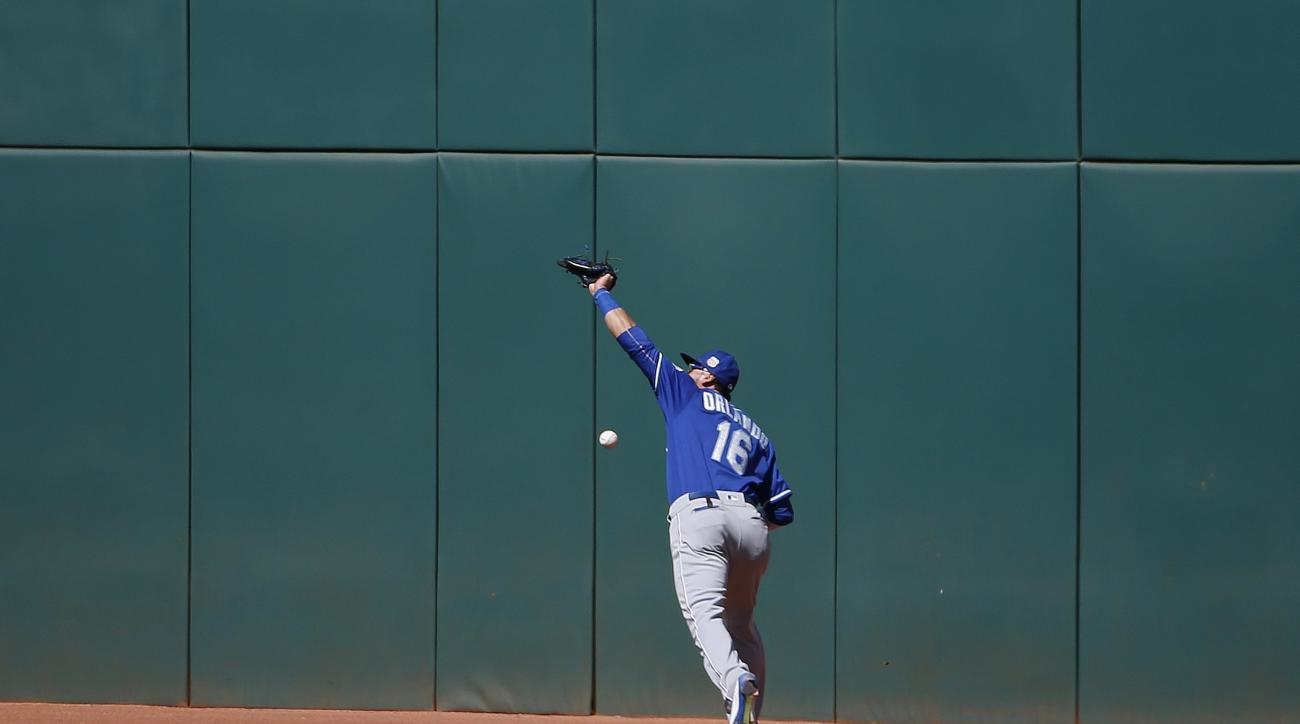 Kansas City Royals' Paulo Orlando is unable to make a catch on a fly ball hit by Cleveland Indians' Jason Kipnis during the third inning of a spring training baseball game Wednesday, March 23, 2016, in Goodyear, Ariz. (AP Photo/Ross D. Franklin)