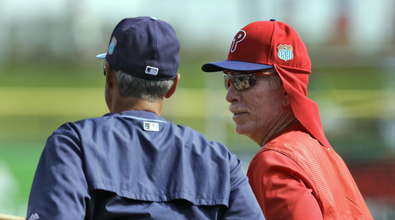"FILE - In this March 17, 2016, file photo, Philadelphia Phillies instructor Mike Schmidt, right, talks to Tampa Bay Rays bench coach Tom Foley before a spring training baseball game in Clearwater, Fla. ""The players used to settle issues themselves. Cross"