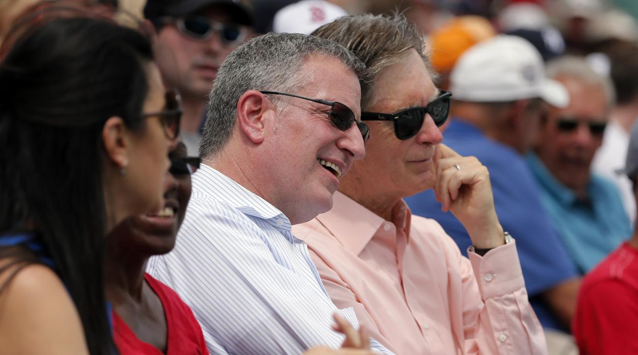 New York City Mayor Bill de Blasio and Boston Red Sox team owner John Henry, right, take in an exhibition spring training baseball game against the New York Mets on Thursday, March 24, 2016, in Fort Myers, Fla. (AP Photo/Tony Gutierrez)
