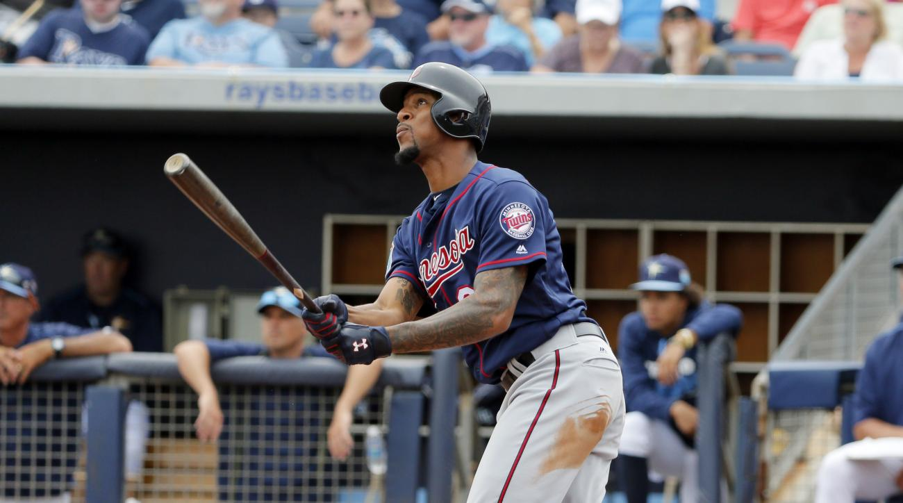 Minnesota Twins' Byron Buxton follows through on sacrifice fly-out off a pitch from Tampa Bay Rays' Drew Smyly in the third inning of a spring training baseball game, Friday, March 25, 2016, in Port Charlotte, Fla. The fly-out scored Kurt Suzuki. (AP Phot