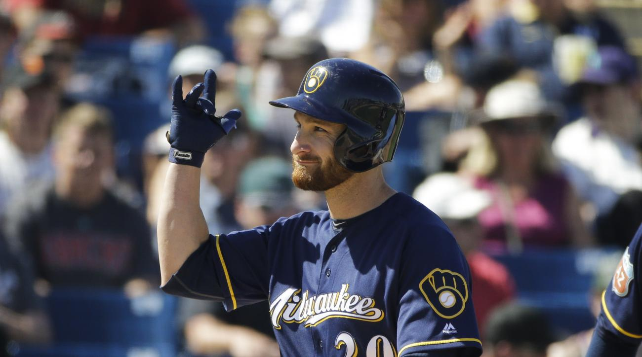 Milwaukee Brewers' Jonathan Lucroy celebrates his home run during the fourth inning of a spring training baseball game against the Arizona Diamondbacks, Saturday, March 26, 2016, in Phoenix. (AP Photo/Jae C. Hong)