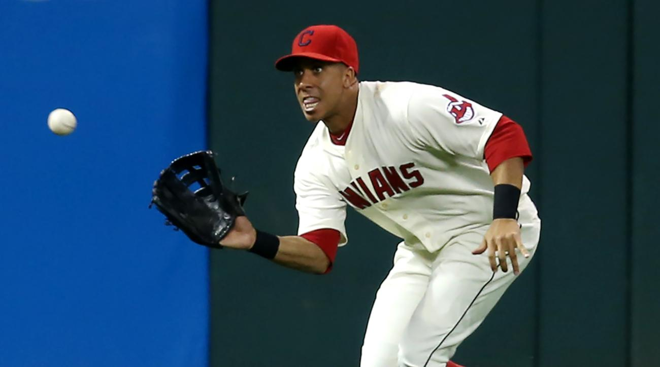 Cleveland Indians left fielder Michael Brantley makes a running catch to put out Chicago White Sox's Micah Johnson during the third inning of a baseball game, Saturday, Sept. 19, 2015, in Cleveland. (AP Photo/Ron Schwane)