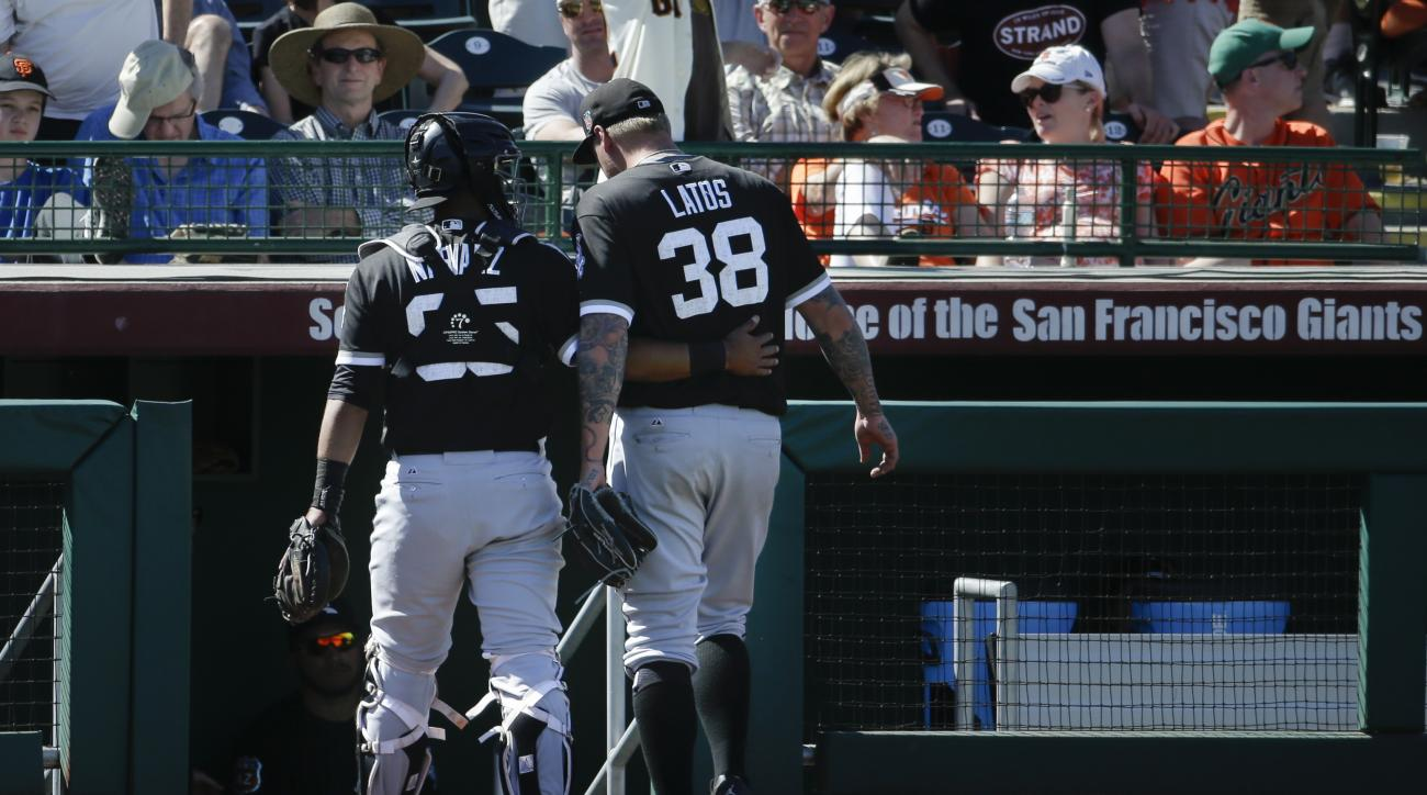Chicago White Sox's Mat Latos (38) speaks with Omar Narvaez, left, at the end of the fourth inning after he gave up the go-ahead run on a balk during a spring training baseball game, Sunday, March 27, 2016, in Scottsdale, Ariz. (AP Photo/Darron Cummings)