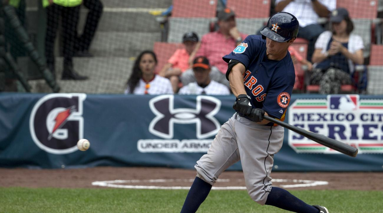 Houston Astros' catcher Garret Stubbs bats during a spring training baseball game with the San Diego Padres in Mexico City, Sunday, March 27, 2016. (AP Photo/Eduardo Verdugo)