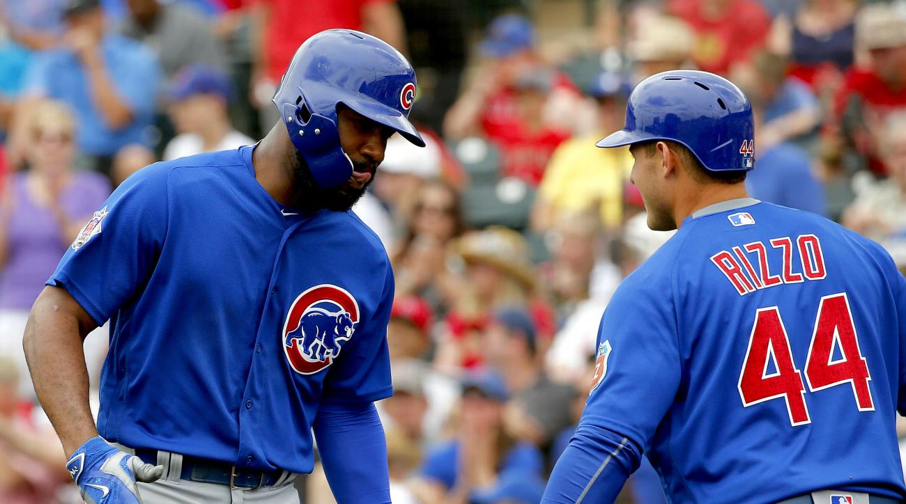 Chicago Cubs' Jason Heyward greets teammate Anthony Rizzo after hitting a three-run home run against the Los Angeles Angels during the third inning of a spring training baseball game, Monday, March 28, 2016, in Tempe, Ariz. Rizzo hit a solo home run durin