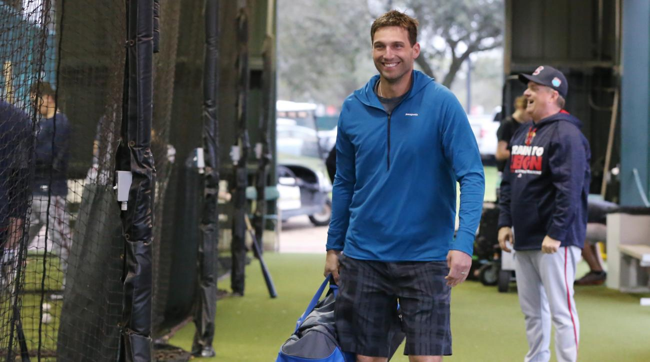 FILE - In this Feb. 24, 2016, file photo, Atlanta Braves outfielder Jeff Francoeur smiles as he walks through the batting cages as he arrives with his bag of gear for his first day of spring training baseball practice in Kissimmee, Fla. Francoeur has made
