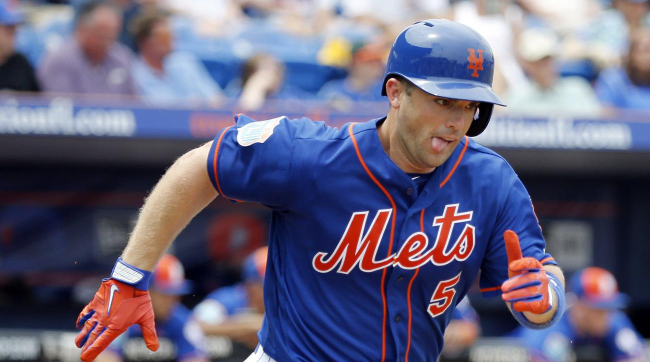 New York Mets' David Wright runs to first base with his tongue out during the third inning of an exhibition spring training baseball game against the Miami Marlins, Tuesday, March 29, 2016, in Port St. Lucie, Fla. (AP Photo/Brynn Anderson)