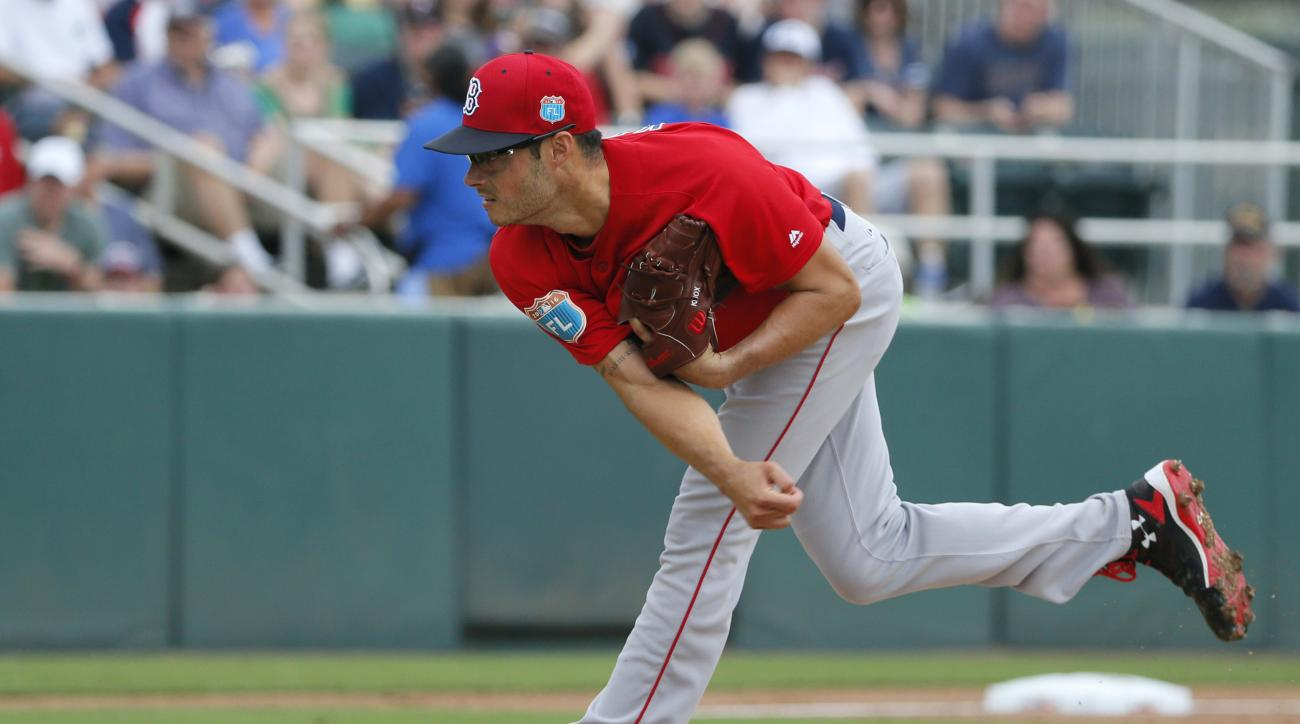 Boston Red Sox starting pitcher Joe Kelly follows through on his delivery to the Minnesota Twins in the first inning of a spring training baseball game, Tuesday, March 29, 2016, in Fort Myers, Fla. (AP Photo/Tony Gutierrez)