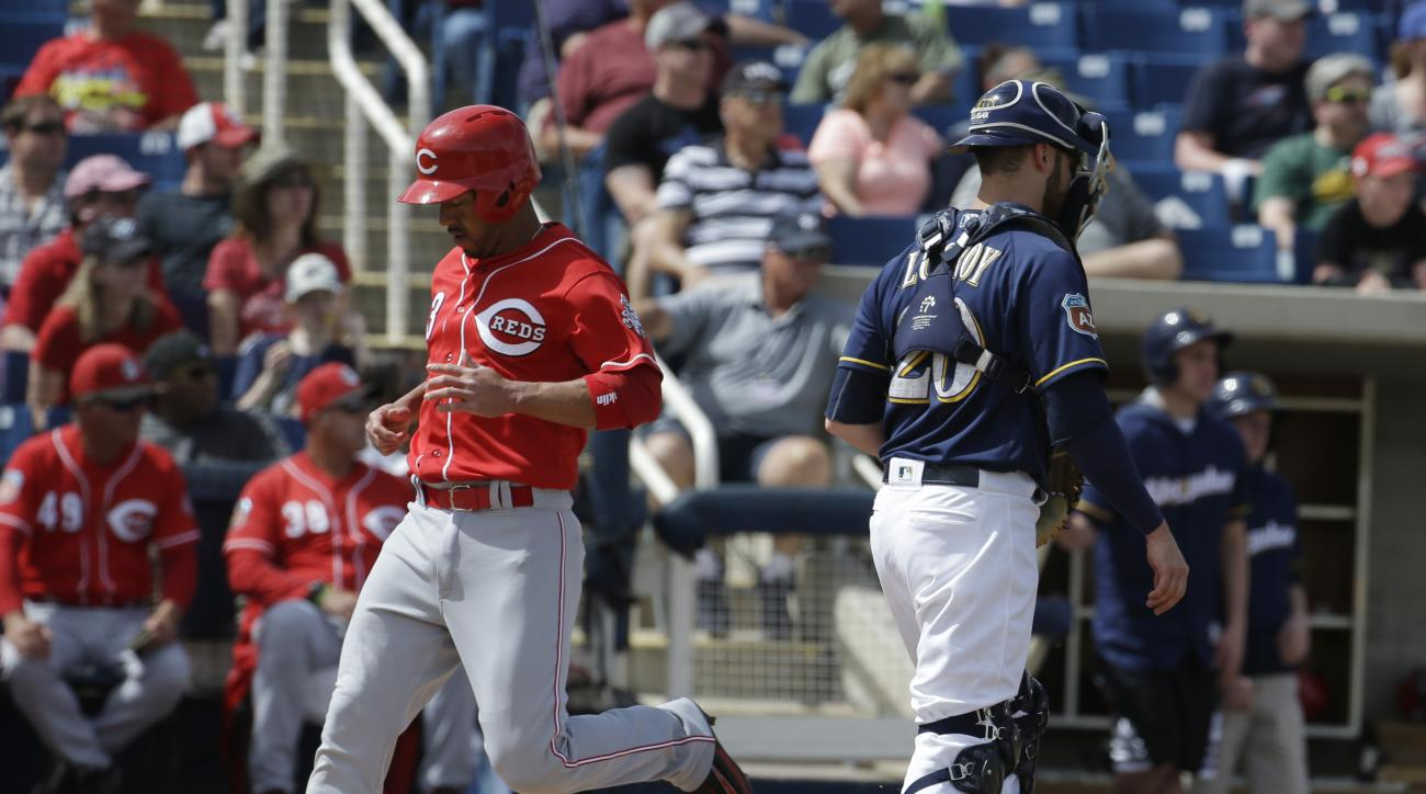 Cincinnati Reds' Ivan De Jesus Jr. scores past Milwaukee Brewers catcher Jonathan Lucroy during the fourth inning of a spring training baseball game Tuesday, March 29, 2016, in Phoenix. (AP Photo/Darron Cummings)