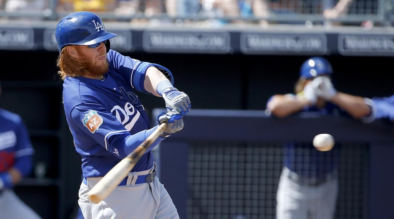 Los Angeles Dodgers' Justin Turner starts his swing before connecting for a home run against the San Diego Padres during the fifth inning of a spring training baseball game Tuesday, March 29, 2016, in Peoria, Ariz. (AP Photo/Ross D. Franklin)