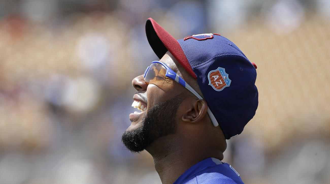 Texas Rangers shortstop Elvis Andrus smiles before the team's spring training baseball game against the Chicago White Sox in Glendale, Ariz., Tuesday, March 29, 2016. (AP Photo/Jeff Chiu)