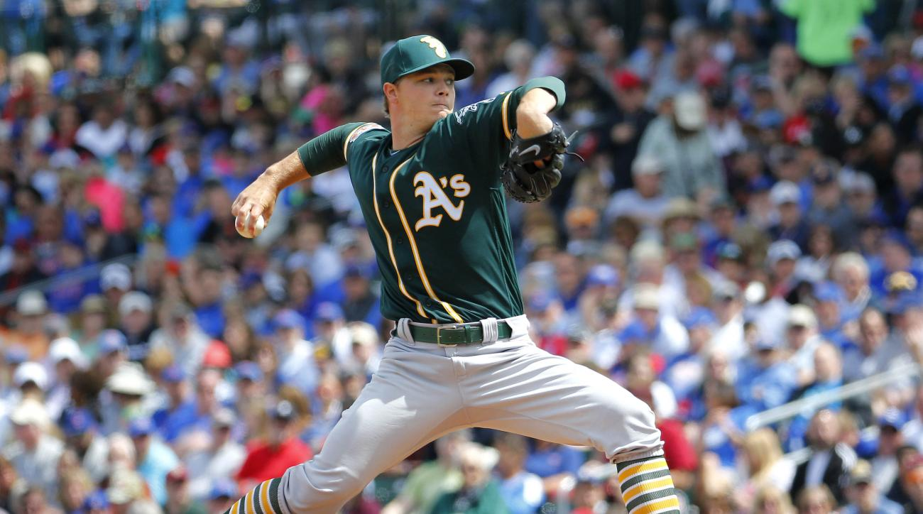 Oakland A's pitcher Sonny Gray throws against the Chicago Cubs during the first inning of a spring training baseball game, Tuesday, March 29, 2016, in Mesa, Ariz. (AP Photo/Matt York)