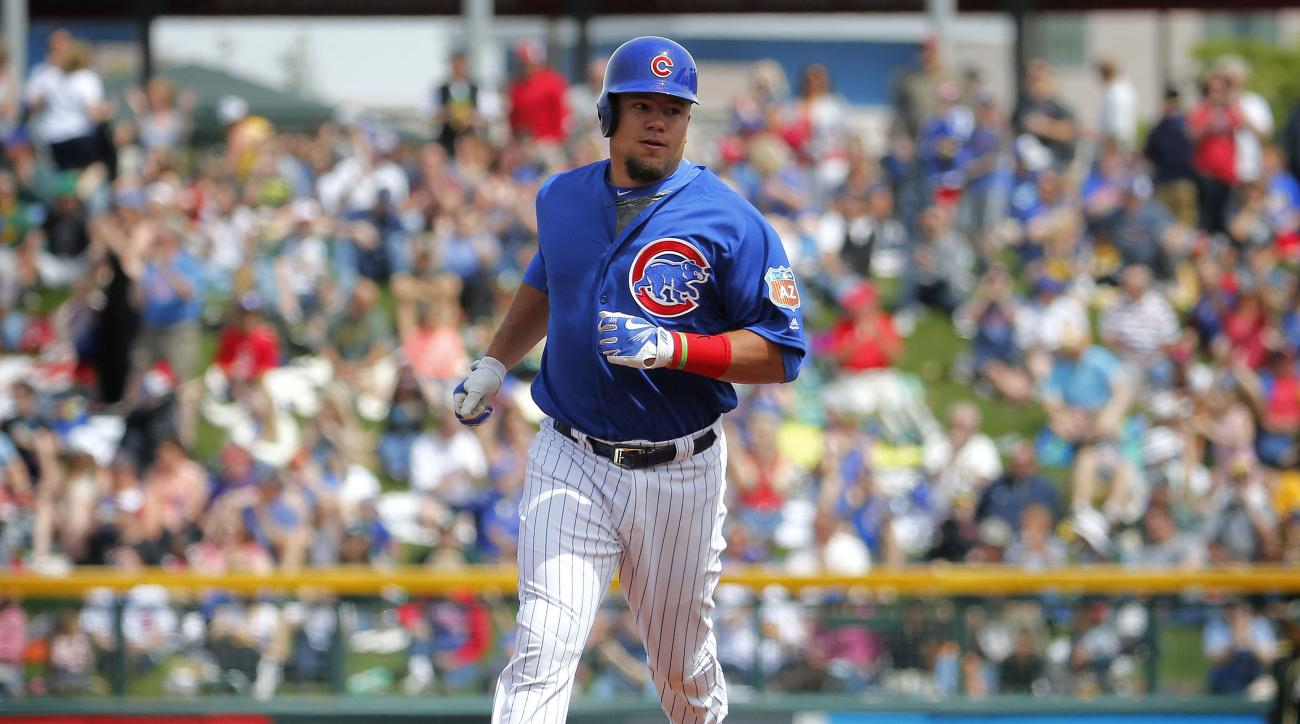 Chicago Cubs' Kyle Schwarber (12) rounds the bases after hitting a solo home run during the first inning of a spring training baseball game against the Oakland Athletics, Tuesday, March 29, 2016, in Mesa, Ariz. (AP Photo/Matt York)