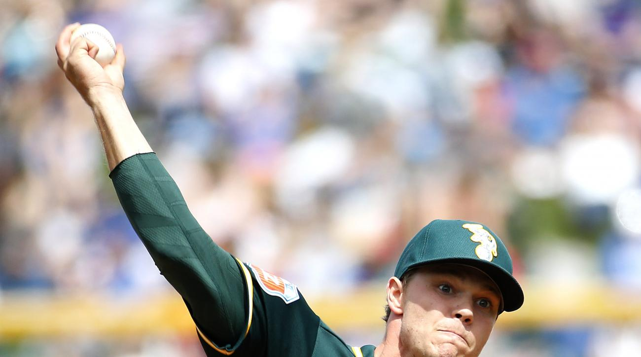Oakland Athletics pitcher Sonny Gray warms up prior to a spring training baseball game against the Chicago Cubs, Tuesday, March 29, 2016, in Mesa, Ariz. (AP Photo/Matt York)