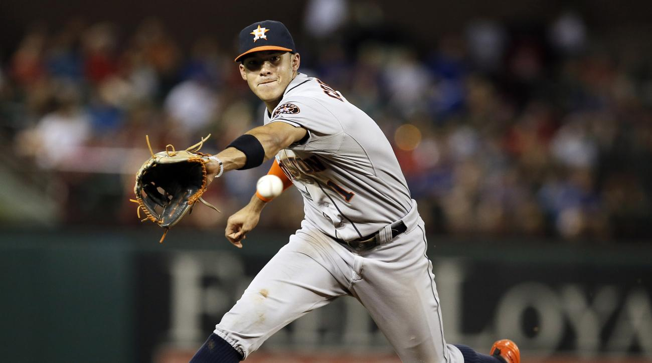 FILE - In this Aug. 5, 2015, file photo, Houston Astros shortstop Carlos Correa reaches out to field a grounder by Texas Rangers' Adrian Beltre during a baseball game in Arlington, Texas. Correa and the Astros face Mike Trout and the Los Angeles Angels in