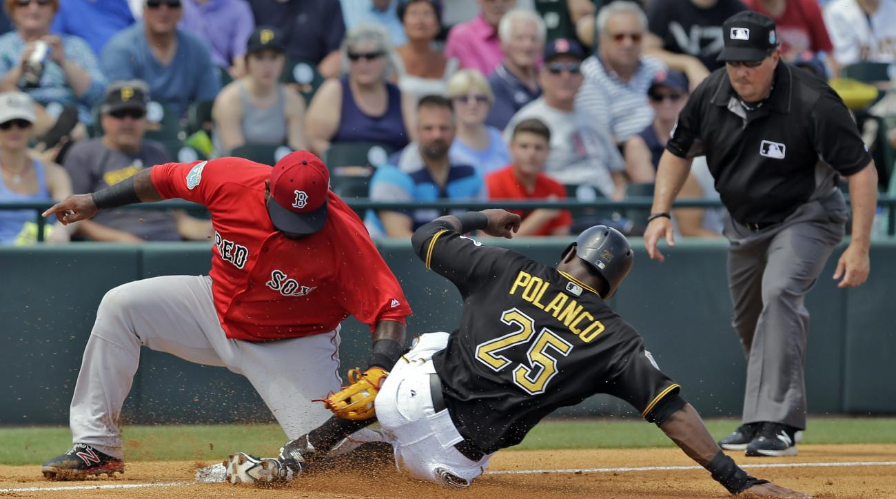 Boston Red Sox third baseman Pablo Sandoval tags out Pittsburgh Pirates' Gregory Polanco (25) at third base while trying to steal during the fourth inning of a spring training baseball game Wednesday, March 30, 2016, in Bradenton, Fla. (AP Photo/Chris O'M